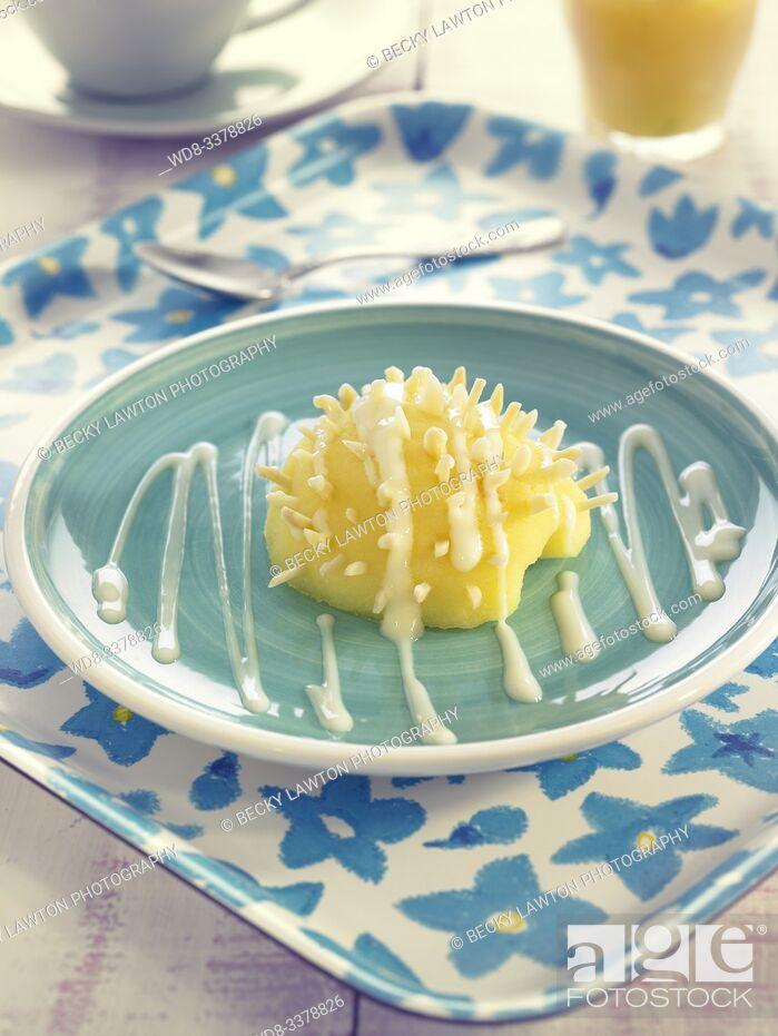 Stock Photo: erizo de manzana con natillas / apple hedgehog with custard.