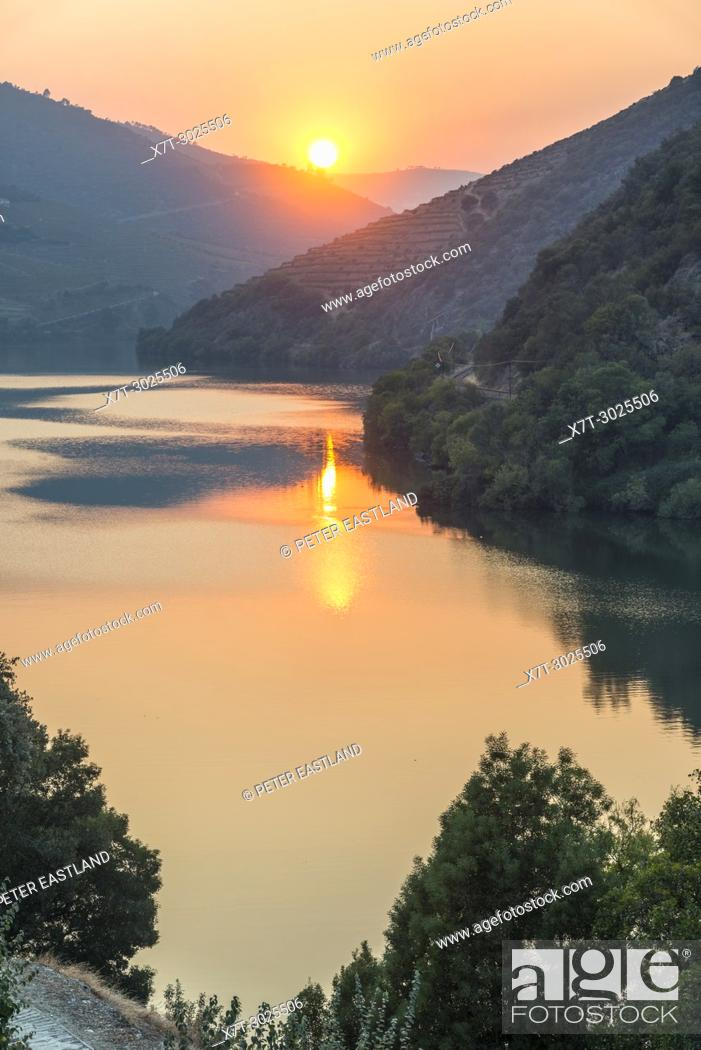 Stock Photo: The River Douro at sunset between Folgosa and Pinhao. In the Alto Douro wine region, Northern Portugal.