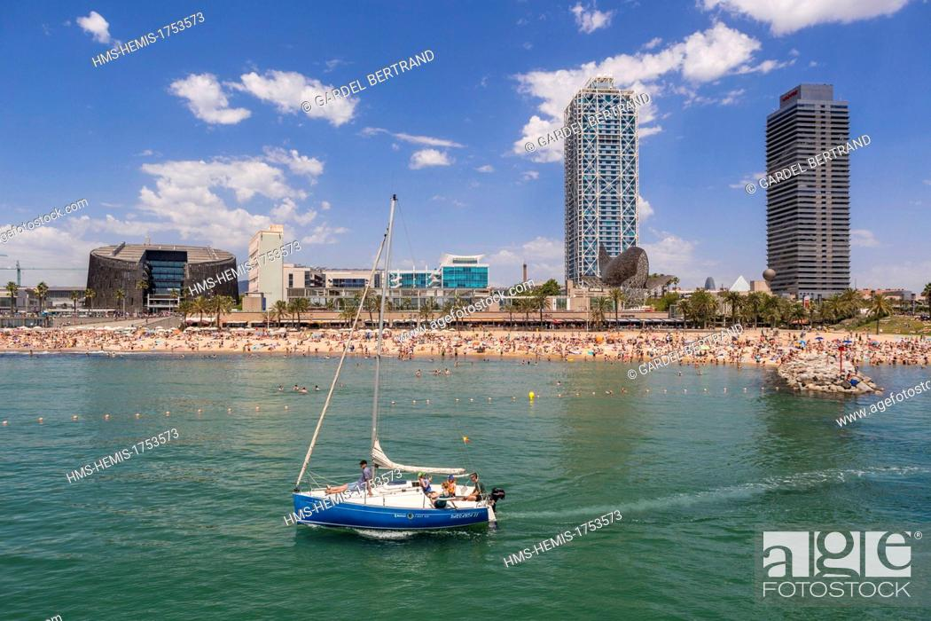 Stock Photo: Spain, Catalonia, Barcelona, the Barceloneta beach, in the background or the Peix Ballena (Whale) by Frank O. Gehry, the towers of the Hotel Arts and Mapfre.