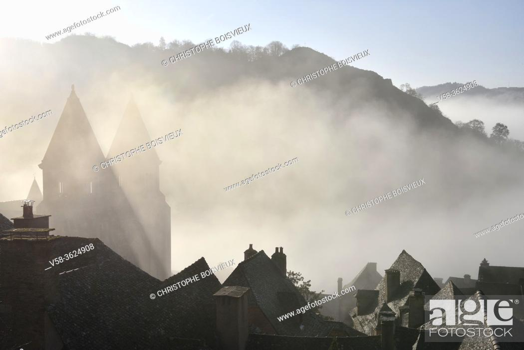 Stock Photo: France, Aveyron, Unesco World Heritage Site, Conques, Early morning on the village and abbey church of Sainte-Foy.