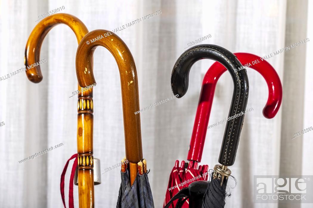 Stock Photo: Used umbrellas and walking sticks.
