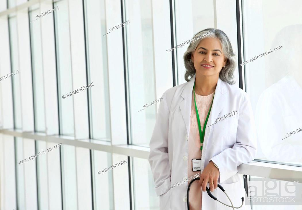 Stock Photo: Portrait of a female doctor smiling.