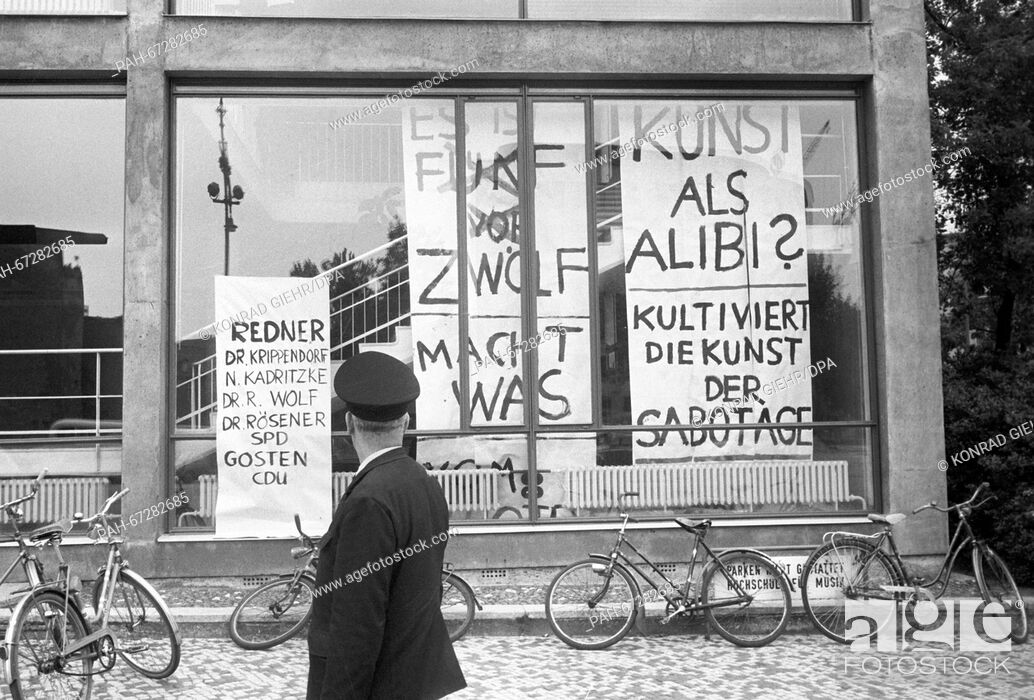 Stock Photo: A pedestrian in front of the college of music in Berlin on 27 May 1968. A panel discussion about the Emergency Law took place in the concert hall of the college.