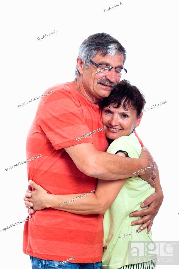 Stock Photo: Portrait of happy middle aged couple hugging, isolated on white background.