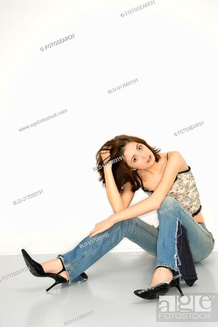 Stock Photo: Portrait of attractive Caucasian redhead young woman.