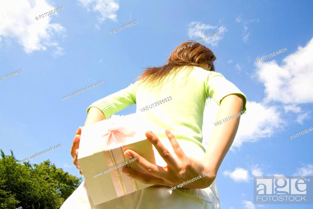 Stock Photo: Woman having a present.