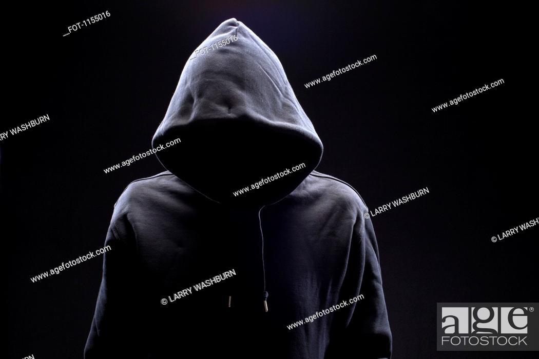 Stock Photo: Hidden man in hooded top.