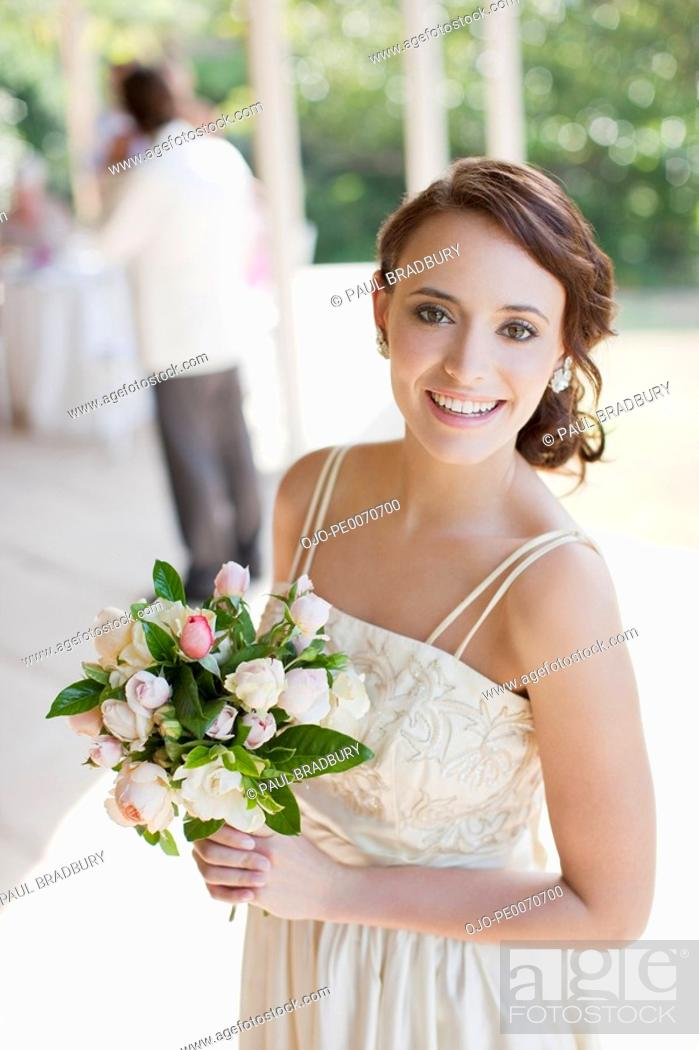 Stock Photo: Bride holding bouquet.