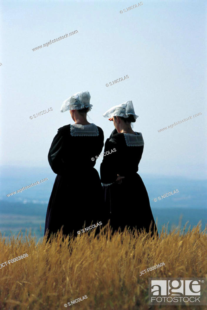Stock Photo: France, Brittany, Women wearing traditional costumes.