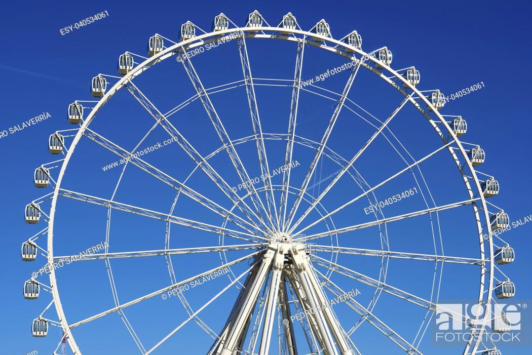 Stock Photo: noria booths with blue sky in Zaragoza, Aragon, Spain.