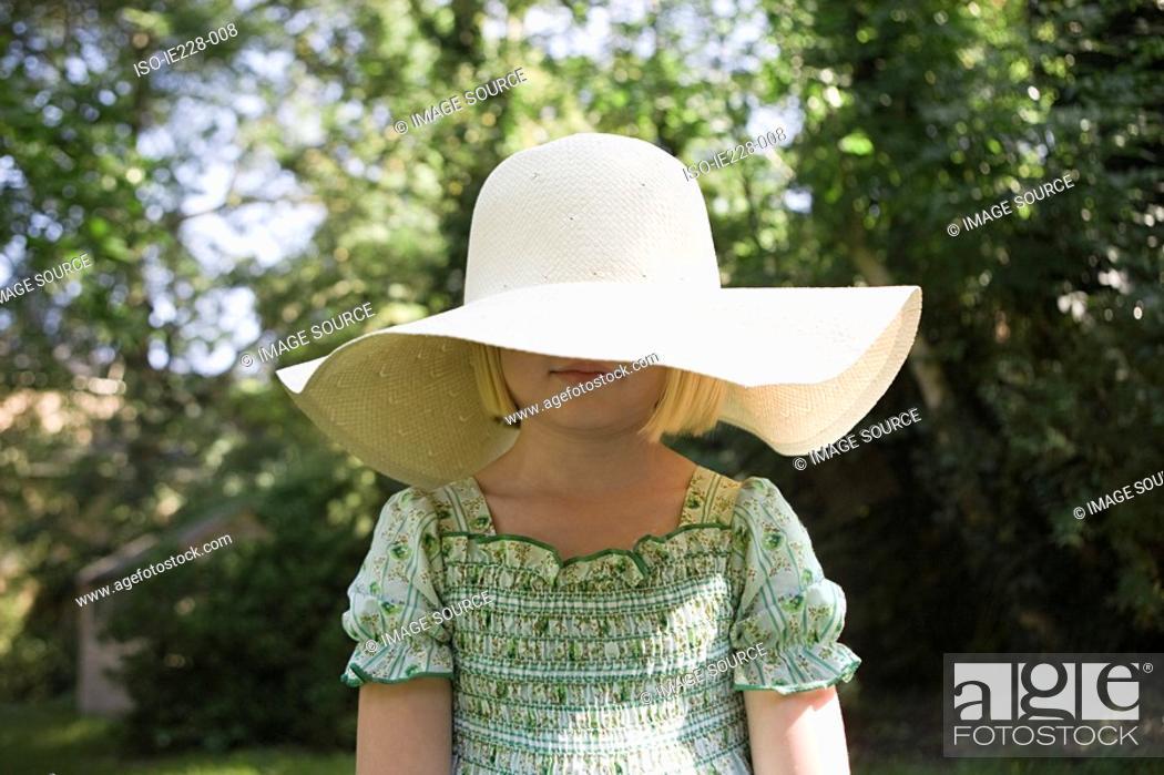 Stock Photo: Girl wearing a large sun hat.