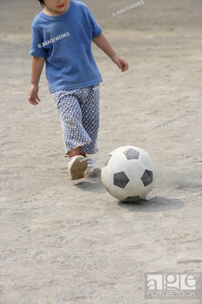 Stock Photo: A boy with succor ball.