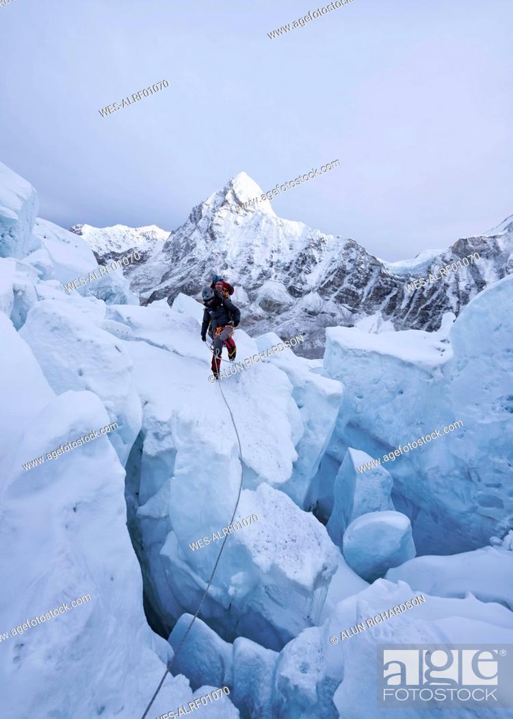 Stock Photo: Nepal, Solo Khumbu, Mountaineers on Everest Icefall, Pumori.