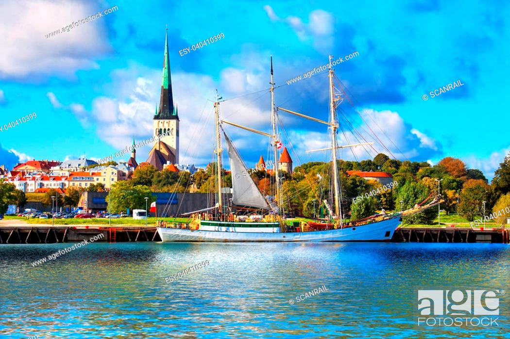 Stock Photo: Scenic summer panorama of pier with historical tall sailing ship in the Old Town in Tallinn, Estonia.