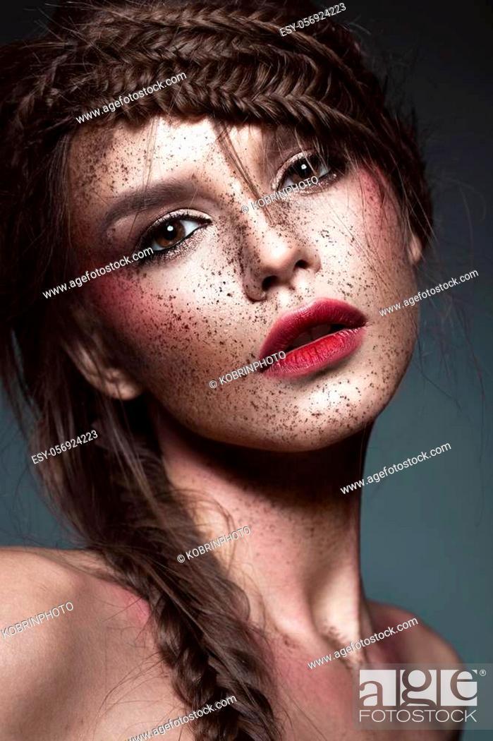Stock Photo: Beautiful strange girl with creative art make-up. Beauty face. Photo taken in studio.