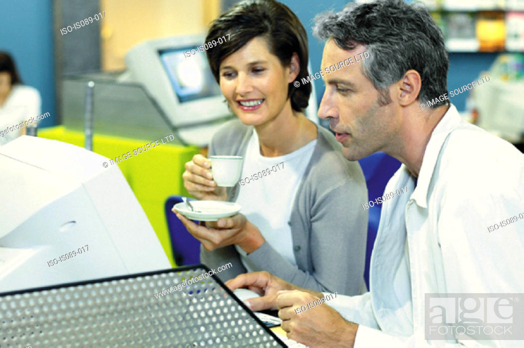 Stock Photo: Man and woman in travel agent.