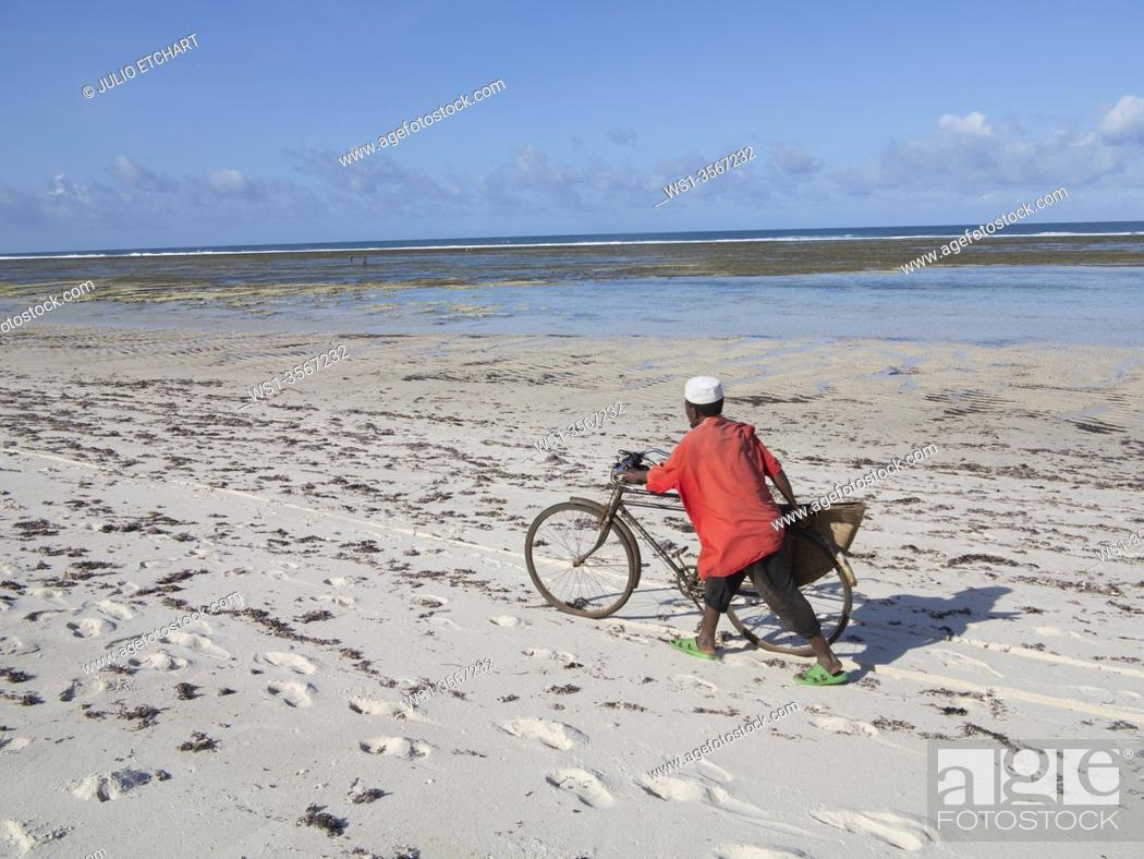 Stock Photo: Local man and bicycle on the beach at Tiwi, on Indian Ocean coast, Kenya.