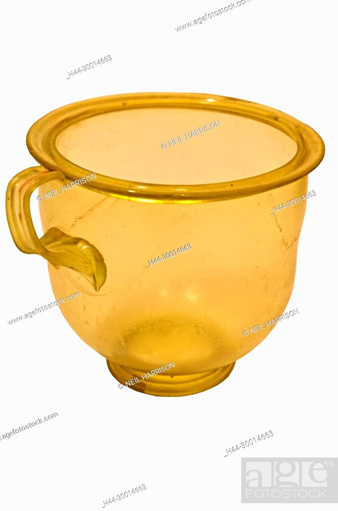 Stock Photo: Ancient roman green glass cup from the 2nd century AD, with shaped handle. Isolated against a white background.
