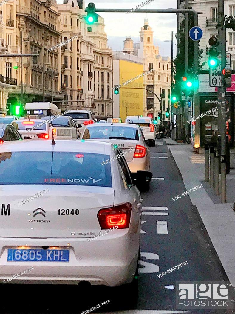 Stock Photo: Taxis in Gran Via street. Madrid, Spain.