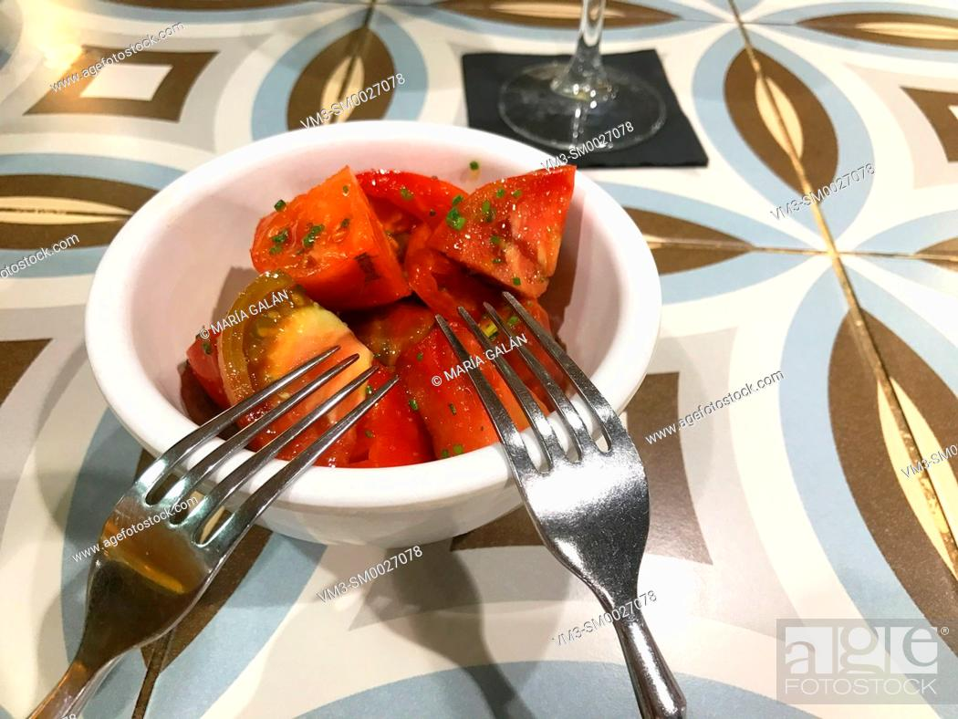 Photo de stock: Tomato salad in a bowl with two forks.
