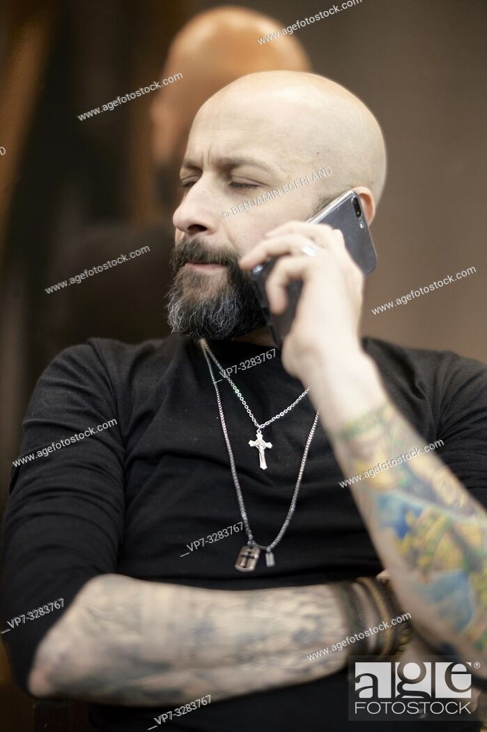 Stock Photo: man using smartphone.