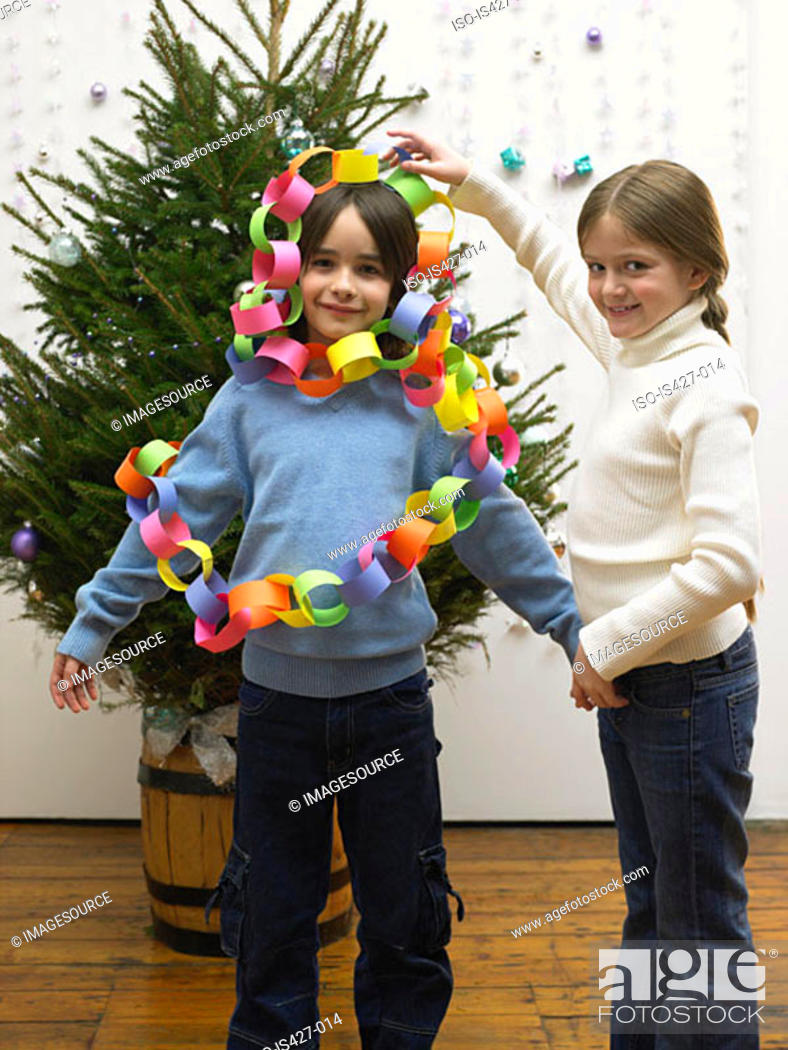 Stock Photo: Brother and sister decorating christmas tree.