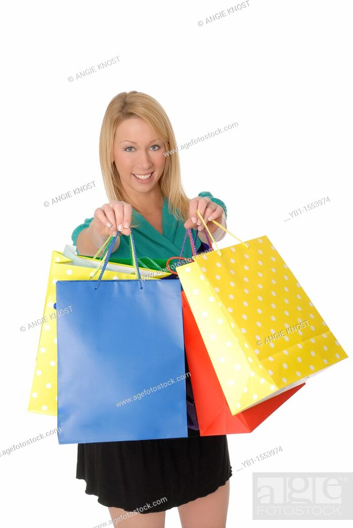 Stock Photo: Pretty Woman Holding Up Colorful Shopping Bags.