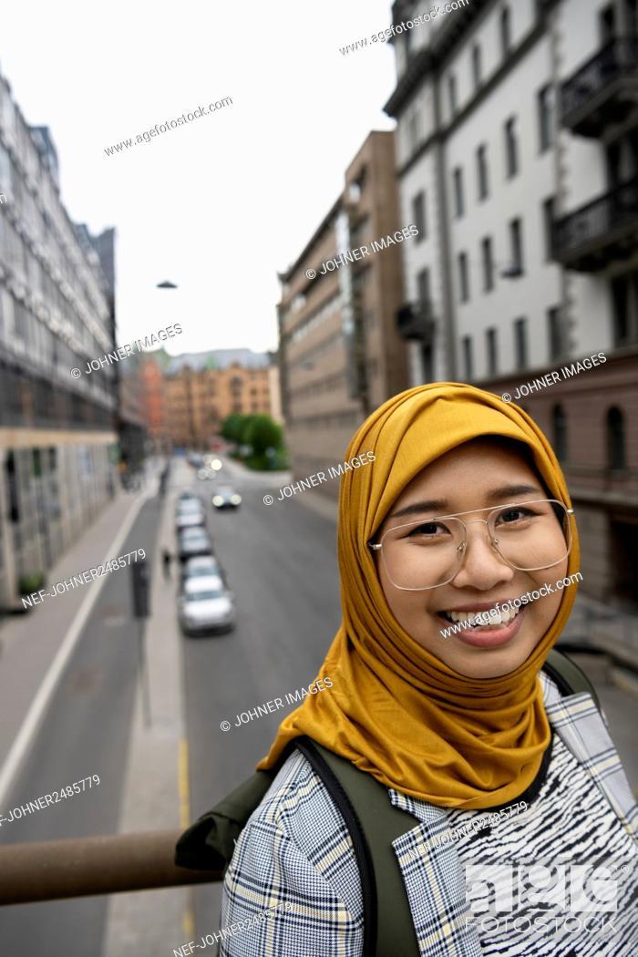 Stock Photo: Smiling young woman looking at camera.