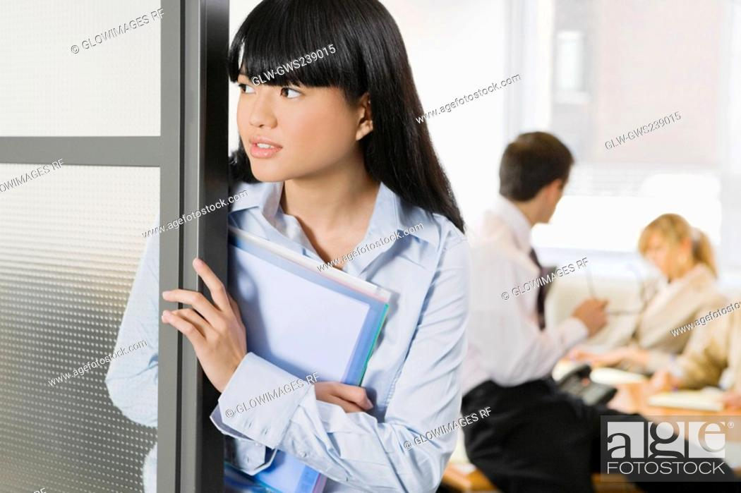 Stock Photo: Close-up of a businesswoman holding files.