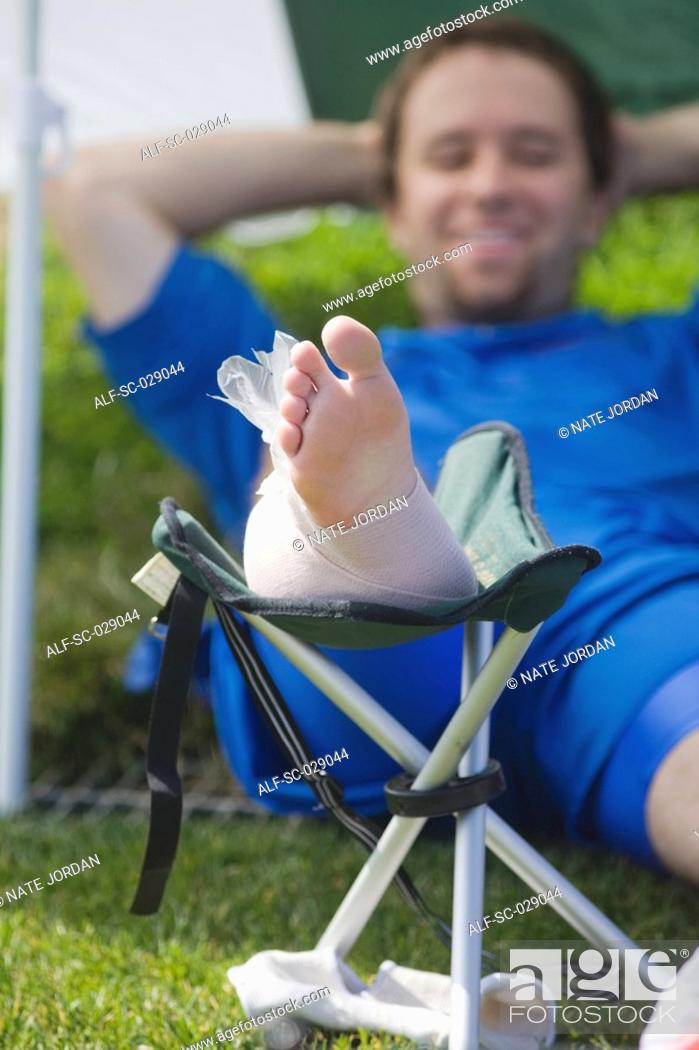 Stock Photo: Soccer Player Icing His Foot.