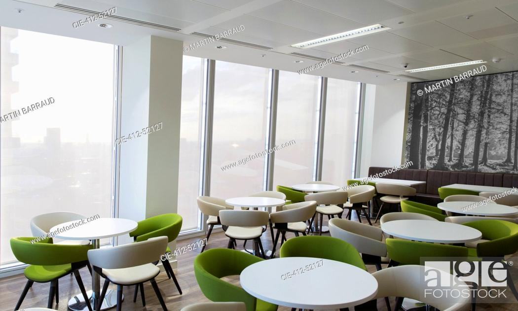 Stock Photo: Tables and chairs in office lounge.
