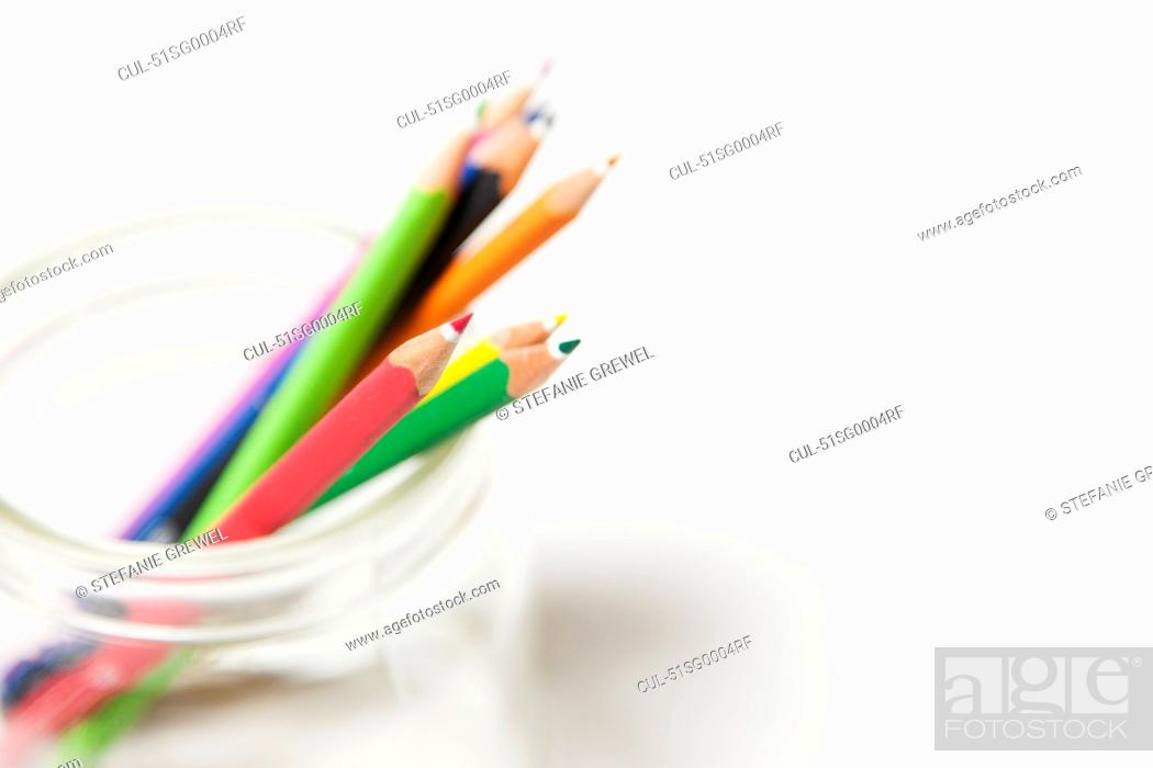 Stock Photo: Close up of colored pencils in jar.