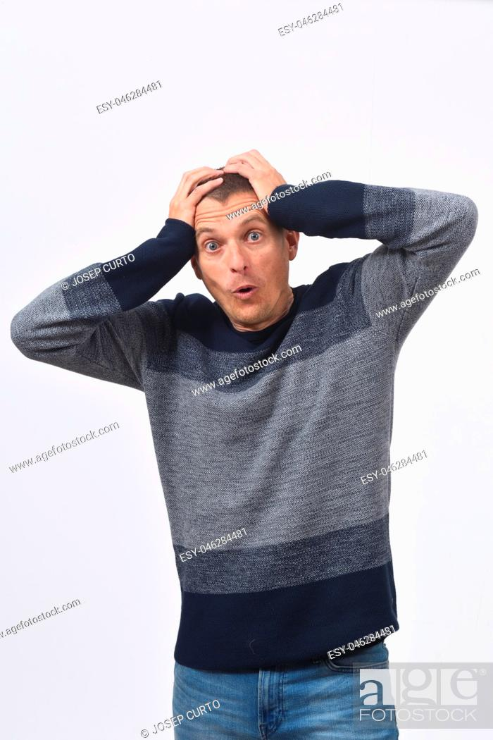 Stock Photo: man with expression of forgetfulness or surprise on white background.