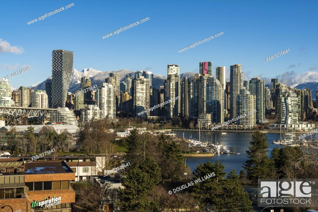 Stock Photo: Skyline, dominated by Vancouver House, designed by Bjarke Ingels Group, from the south side of False Creek, Vancouver, BC, Canada.