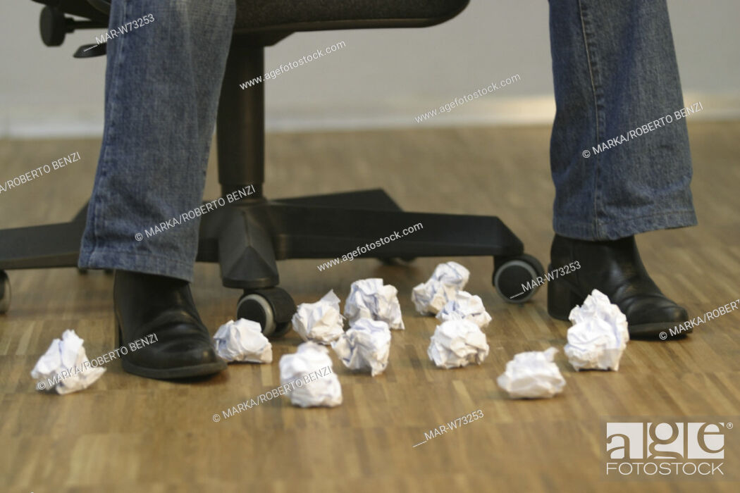 Stock Photo: legs with crumpled paper.