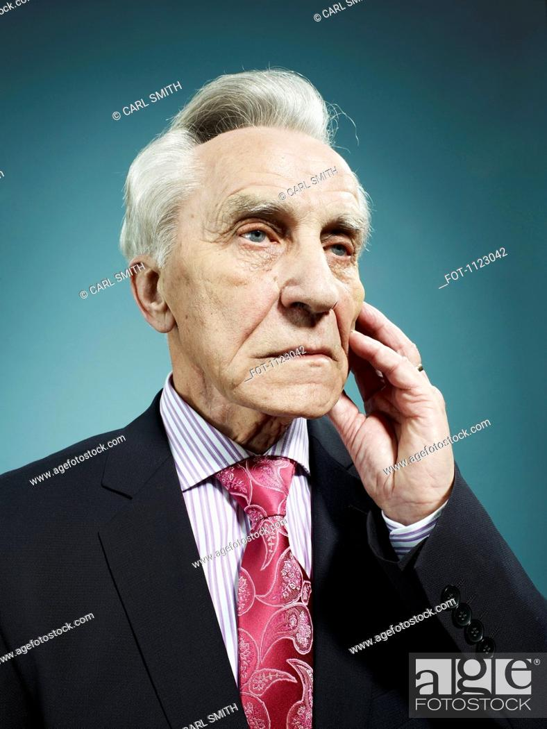 Stock Photo: An elegant senior man looking away with a worried expression.