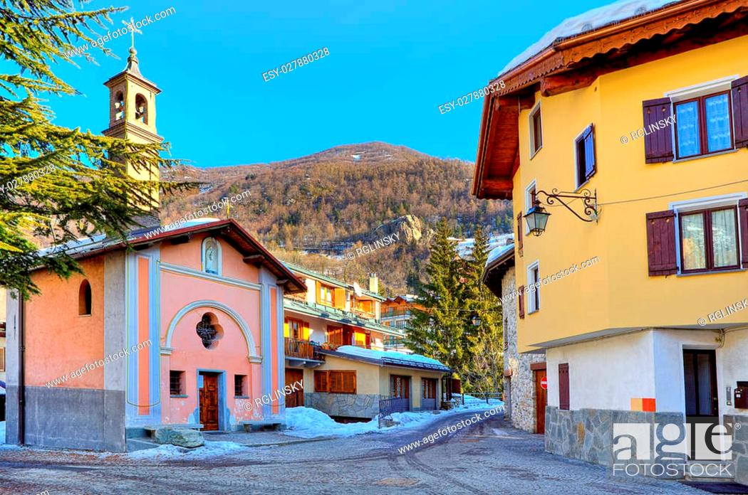 Stock Photo: Small town square surrounded by typical houses and chapel in popular tourist ski resort of Limone Piemonte in Italy.