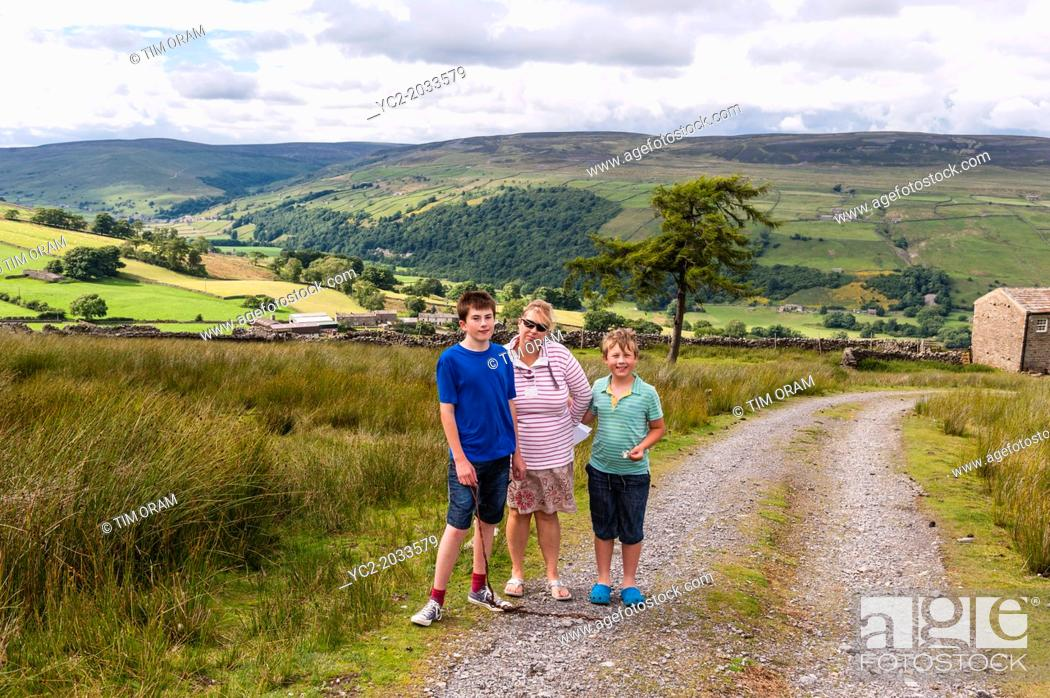 Stock Photo: A mother and her 2 sons out on a family walk in Swaledale , North Yorkshire , England , Britain , Uk.