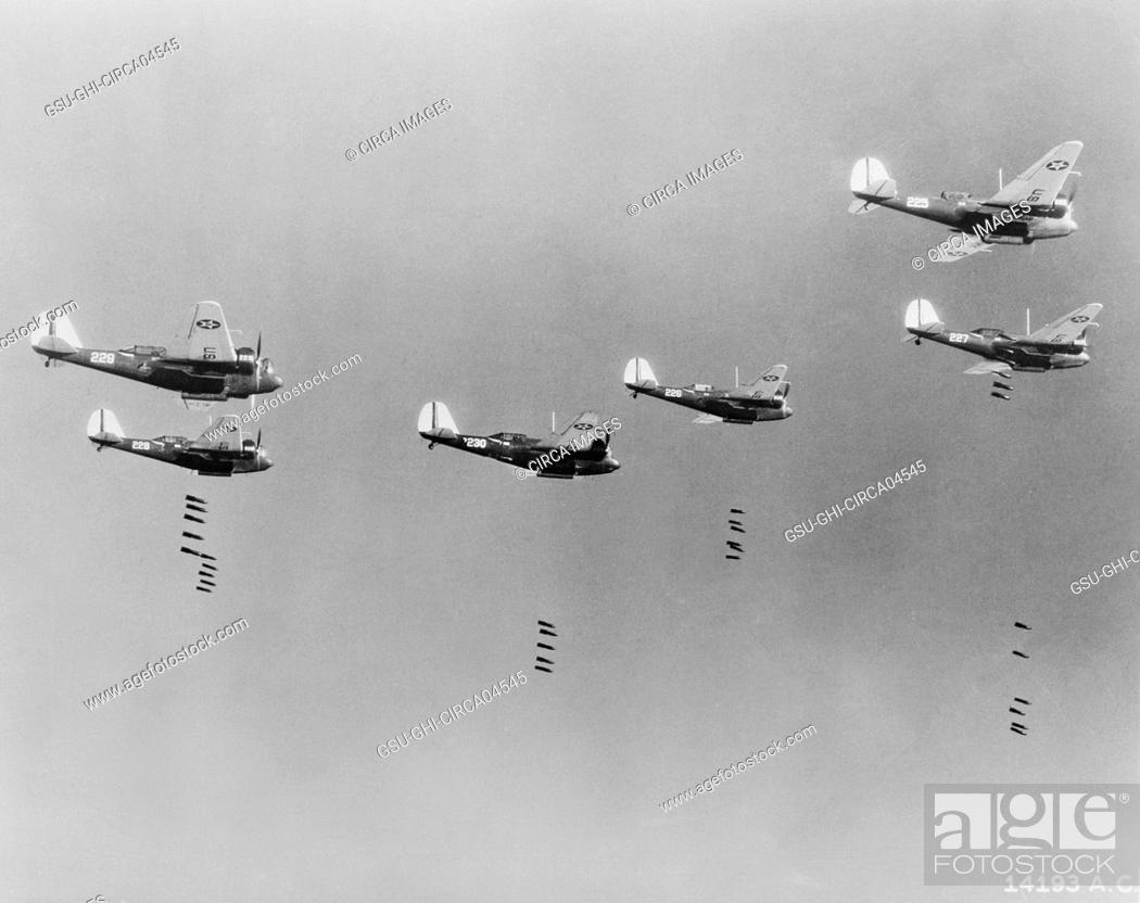 Stock Photo: 600-pound Bombs falling from Formation of B-10 Bombers in Bombing Practice by 19th Bombardment Group, U.S. Army Air Corps, Office of War Information.