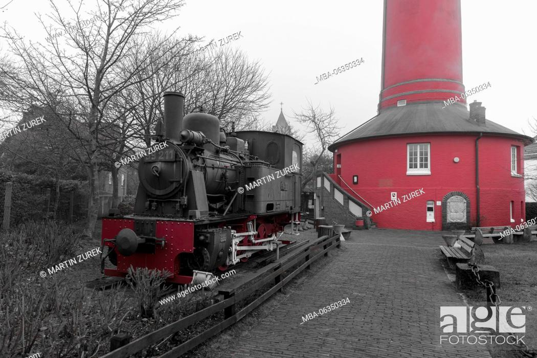 Stock Photo: Old lighthouse and Inselmuseum (museum) on Wangerooge, Germany, Lower Saxony, the North Sea, winter.