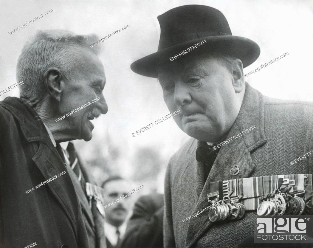 Stock Photo: Winston Churchill, wearing his military medals, listening to an elderly man. Ca. 1945 - (BSLOC-2014-17-46).