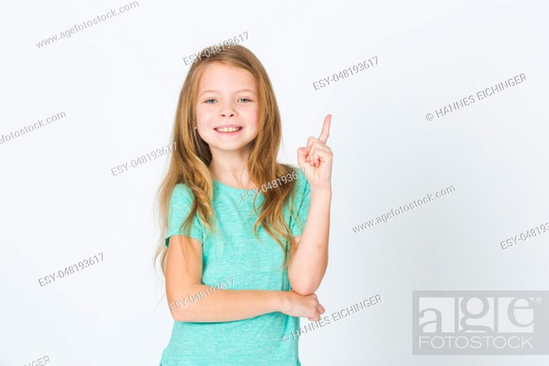 Stock Photo: portrait of young pretty blonde girl thinking in front of white background in the studio.