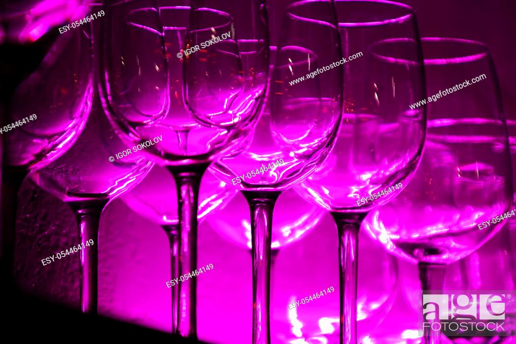 Stock Photo: 12 Wine glasses and glasses on a shelf in a bar, night club, many colors.