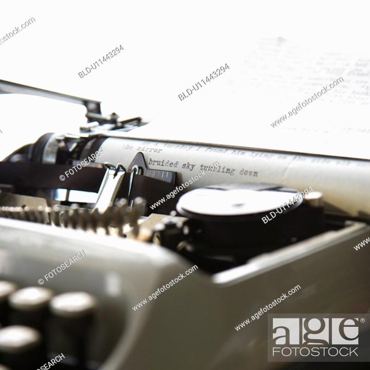 Stock Photo: Paper with text inside typewriter.