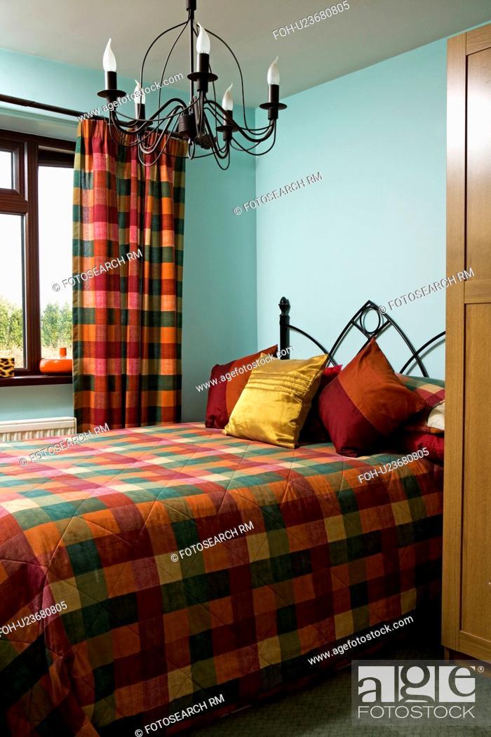 Metal chandelier in pastel turquoise bedroom with ...