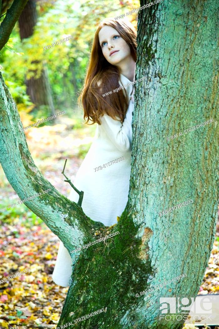 Stock Photo: Ginger woman in autumn park.