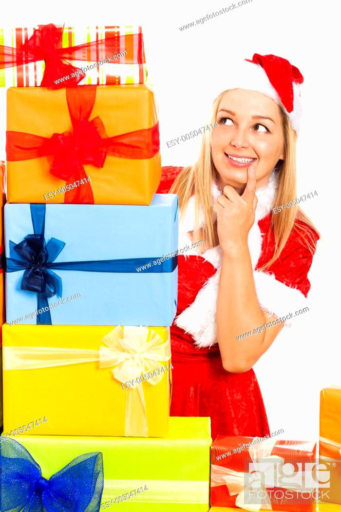 Stock Photo: Young blond happy cute woman in Santa costume surrounded by Christmas gift boxes, isolated on white background.