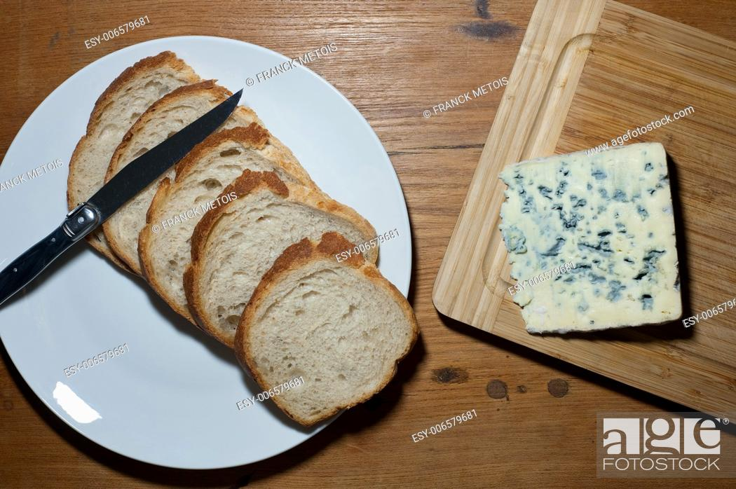 """Stock Photo: French cheese called """"""""bleu d'Auvergne"""""""" and sliced bread."""