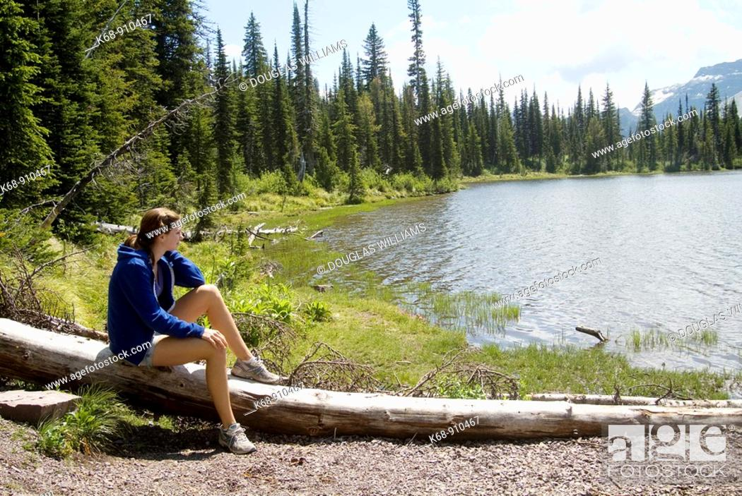 Stock Photo: 17 year old girl by Summit Lake, Waterton Lakes National Park, Alberta, Canada.