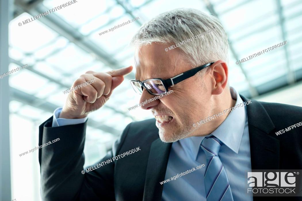Stock Photo: Germany, Stuttgart, Angry businessman, close up.